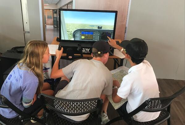 Students in the Redbird STEM Lab at EAA AirVenture