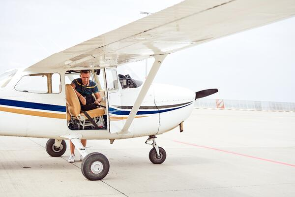 Student pilot doing a preflight at flight school