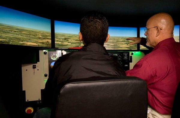 Flight Instructor and Student Pilot in Flight Simulator